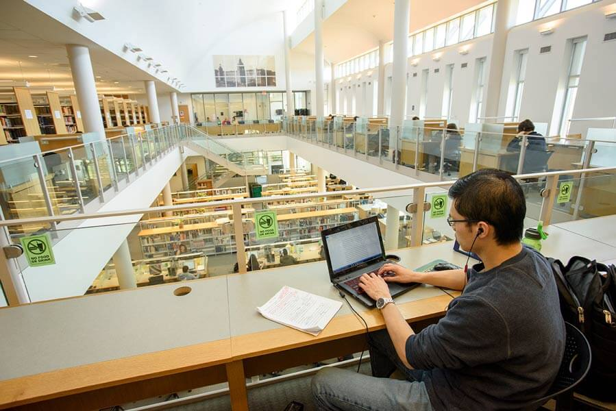 A student is hard at work in the Welter library