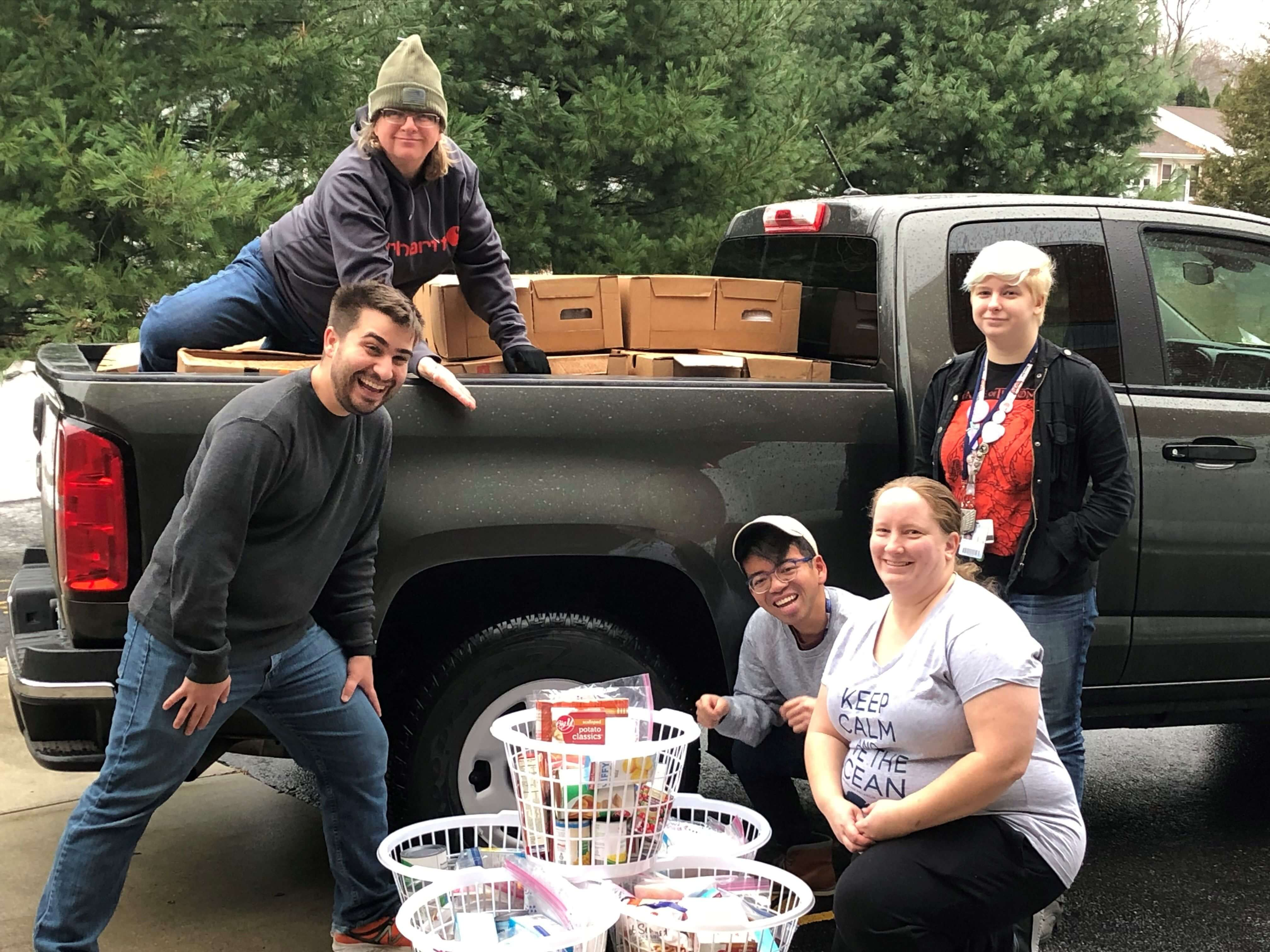 Three Rivers Community College students Cody Sowell, Thena Cranfill, Joe Victorino, Marie Parry and Samantha Bartosiak load a pick-up truck with turkeys and Thanksgiving fixings to bring to the Norwich Vet Center.