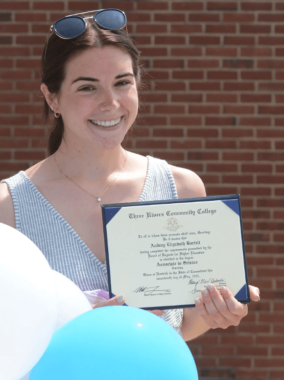 Audrey Bartlet smiling with her degree