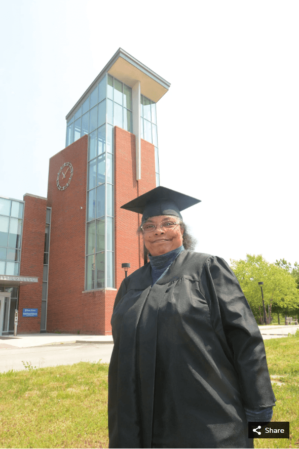 cinderella mosley smiling with cap and gown