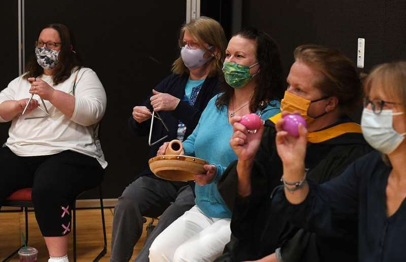 faculty cheering for graduates with noise makers