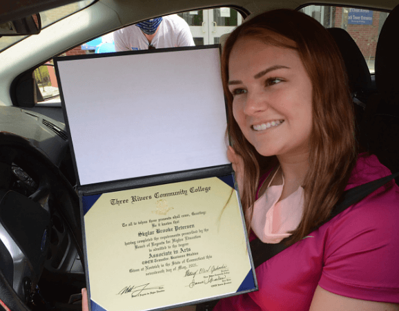 skylar peterson smiling with her degree